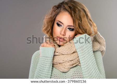 Sexy blond woman in winter clothes  - stock photo
