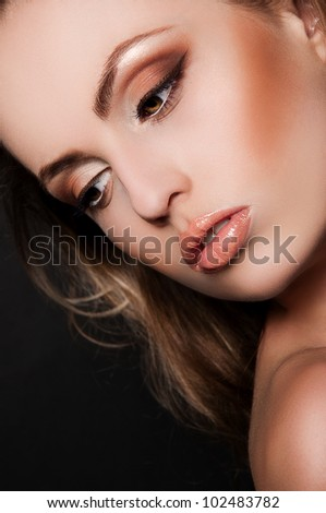 sexy blond woman on black background