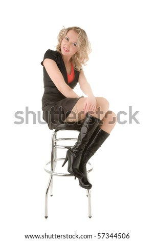 Sexy blond woman sitting on a bar chair