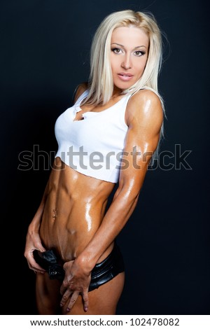 Sexy blond woman with a gorgeous toned body - stock photo