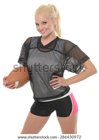 Sexy blonde female American football player (model) posing for shot with ball in studio - stock photo