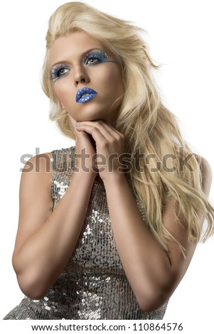 sexy blonde girl with euro flag make-up and glitter dress with hands under the chin, she looks at right - stock photo