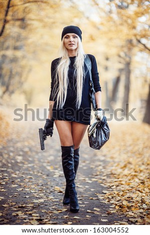Sexy blonde girl with weapon - stock photo