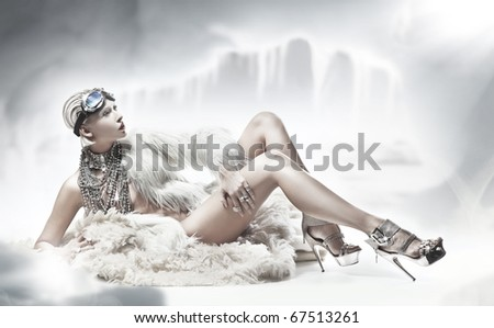 Sexy blonde lady wearing fur - stock photo
