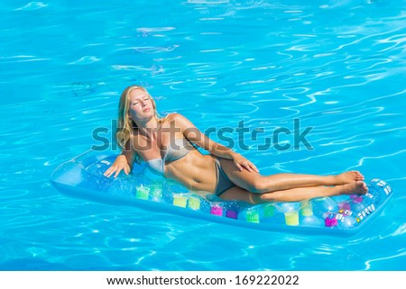 Sexy blonde woman in the swimming pool