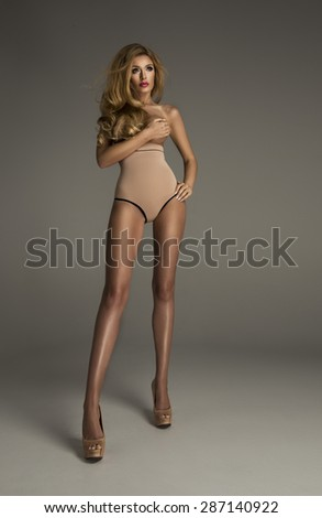 Sexy blonde woman only in pants  - stock photo