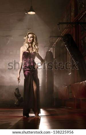 Sexy blonde woman posing in boxing hall - stock photo