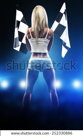 Sexy blonde woman starts racing - stock photo