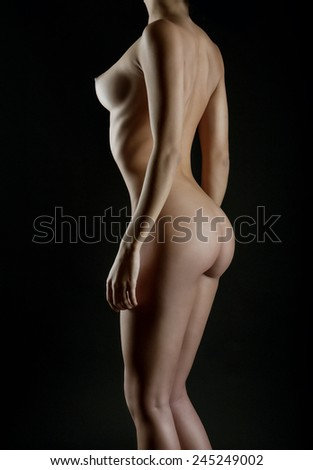 Sexy body nude woman. Naked sensual buttocks isolated on black - stock photo