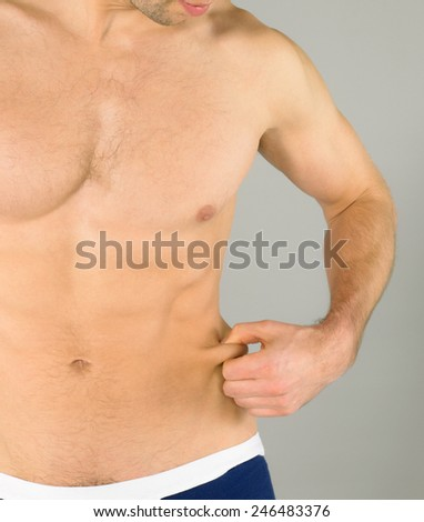 Sexy body of muscular athletic man with weight - stock photo