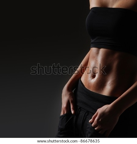 Sexy body of young attractive sporty lady - stock photo