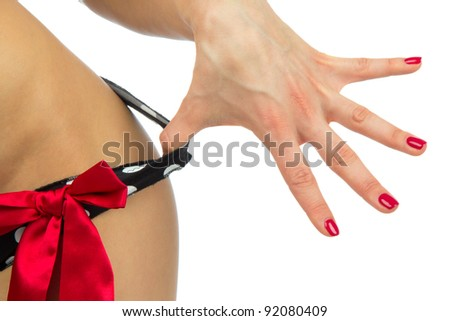 Sexy body of young beautiful caucasian woman taking off her sexy lingerie panties or thongs by hand with perfect manicure shellac on a white background - stock photo
