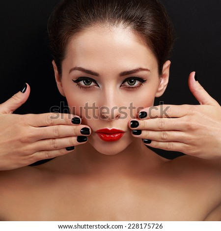 Sexy bright make-up woman with red lipstick and black nails polish. Closeup on black background - stock photo