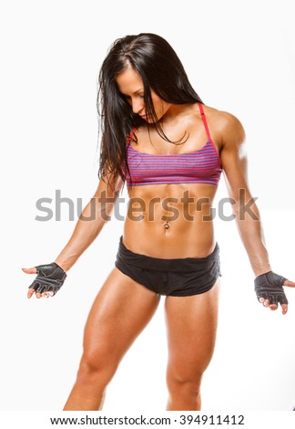 Sexy brunette fitness woman isolated on a white background. - stock photo