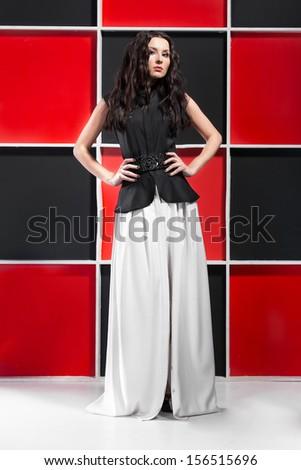 Sexy brunette girl posing in long white skirt  - stock photo