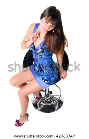 Sexy brunette in a blue dress. Isolated over white background .