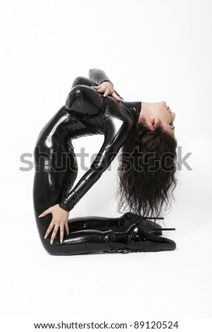 Sexy brunette in black latex costume