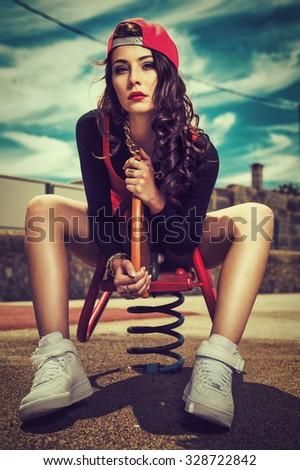 sexy brunette in streetwear - stock photo