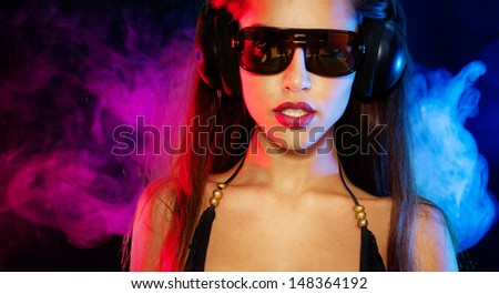 Sexy brunette listening music - stock photo