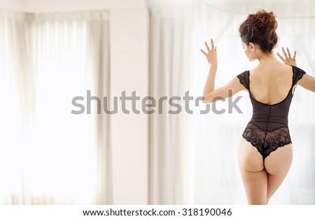 Sexy brunette posing wearing black lingerie - stock photo