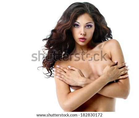 sexy brunette topless covers a breast with hands - stock photo