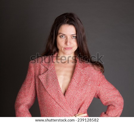 Sexy brunette woman in a tack red and white wool vintage suit jacket - stock photo