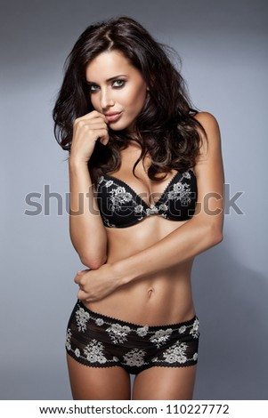 Sexy brunette woman in lingerie - stock photo