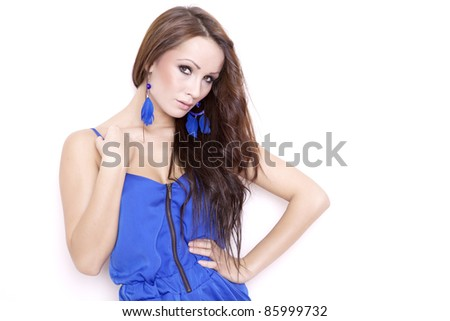 Sexy brunette woman posing in blue dress isolated on white background - stock photo