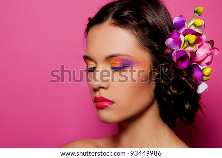 sexy brunette woman with bright make up on pink background