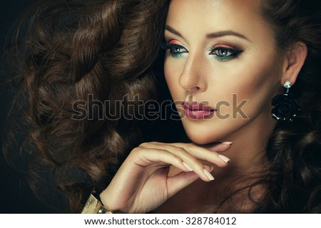 Sexy brunette woman with colorful makeup - stock photo