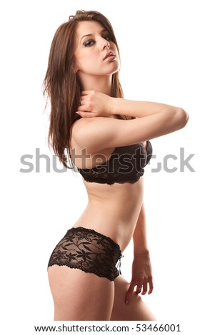 Sexy brunette young lady in laces isolated on white background