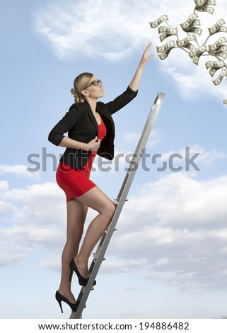 sexy business woman with elegant suit climbing ladder with ambition  - stock photo