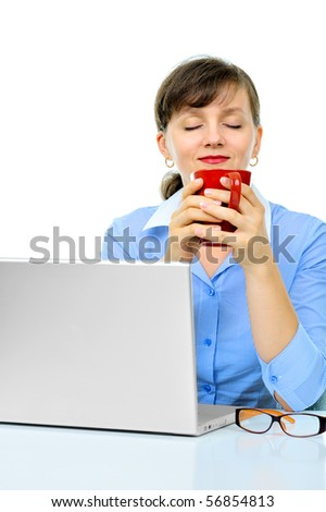 Sexy businesswoman is enjoying a morning coffee on a work place - stock photo