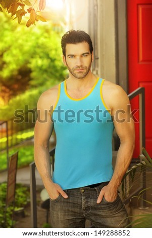 Sexy casual guy outside in relaxed pose - stock photo