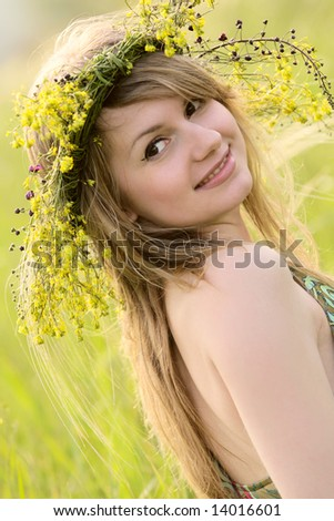 Sexy caucasian girl with flower garland - stock photo