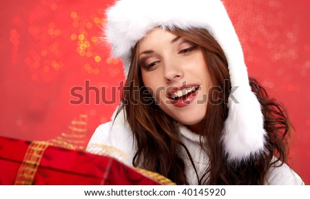 sexy christmas girl smiles and holding a gift in packing