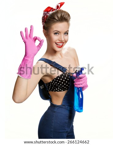 Sexy cleaning girl wearing pink rubber protective gloves holding spray Showing Us It's Okay / young beautiful American pin-up girl isolated on white background. Cleaning service concept - stock photo
