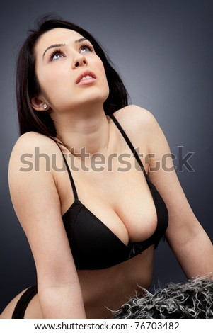 Sexy cleavage - young brunette woman in lingerie - stock photo