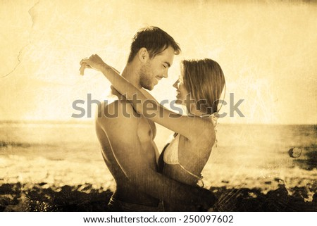 Sexy couple embracing against grey background - stock photo