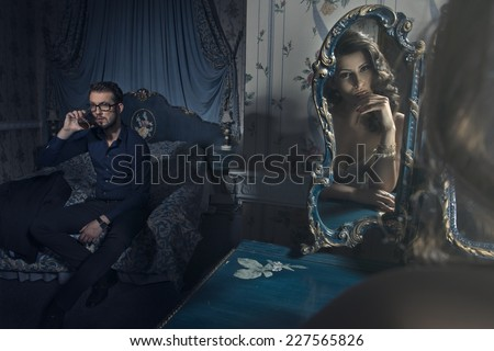 Sexy couple in bedroom. Man drinking  - stock photo
