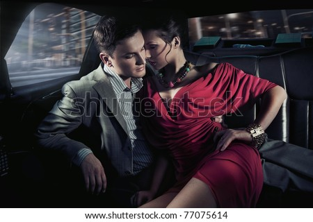 Sexy couple in car - stock photo
