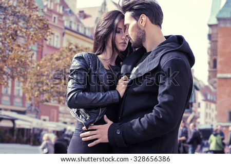 Sexy couple in jacket hugging each other - stock photo