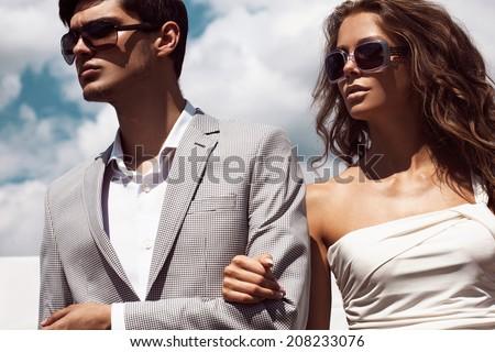 Sexy couple in sunglasses - stock photo