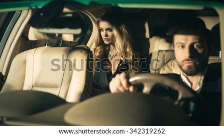 Sexy couple in the car. Focus on woman - stock photo