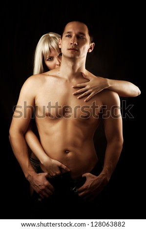 Sexy couple of  lovers hugging. Woman kissing man to the neck - stock photo