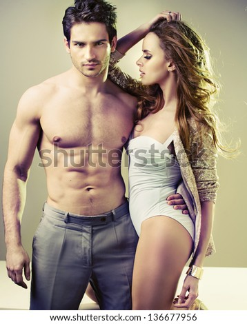 Sexy couple posing - stock photo