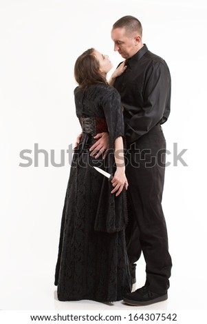 Sexy Couple, Woman with Dagger - stock photo