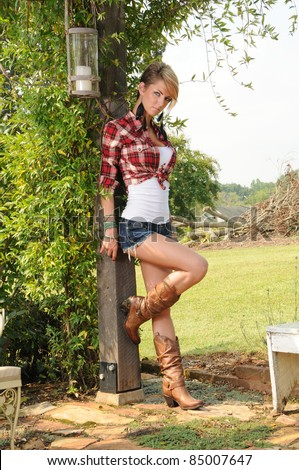 Sexy Cowgirl Girl Outdoors in the Country
