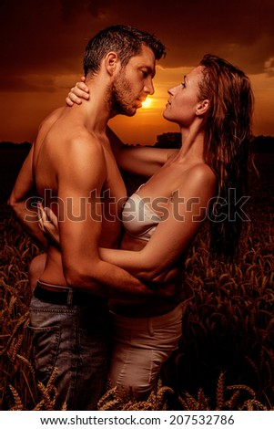 sexy dancing outdoor couple with landscape - stock photo