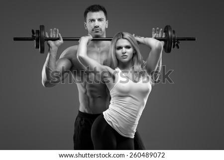 Sexy exerciser couple - stock photo